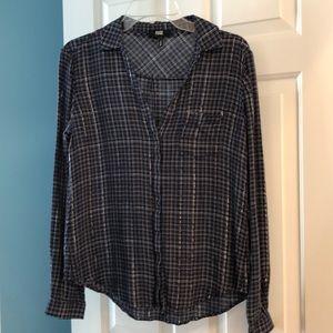 Stylish plaid button down shirt.